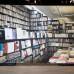 Christian Jankowski, Die Legende des Künstlers und andere Baustellen (Buchhandlung Walther König, Köln), 2013, Acryl auf Leinwand, 394 x 700 cm. Courtesy- the artist
