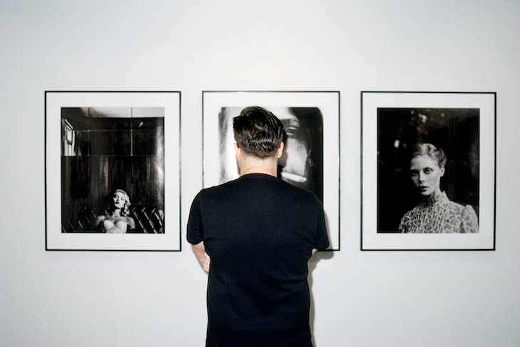 Eirikur Mortagne, Tom Hoops in front of his works at MIA Photo Fair