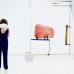 """Carolyn Christov-Bakargiev, künstlerische Direktorin der dOCUMENTA 13 vor einer Installation von Nairy Baghramian """"Drawing Table(Homage to Jane Bowles)"""" (2017), EMST."""